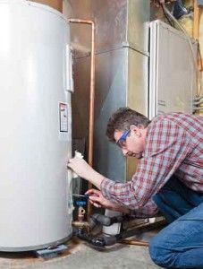 Man Inspecting Water Heater